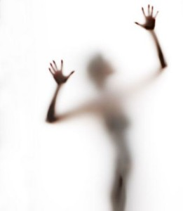 abstract, elongated, semi-obscured figure with arms raised